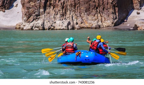 Young persons rafting on the Ganges river in Rishikesh, extreme and fun sport at tourist attraction