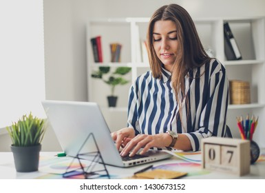 Young perspective web designer and blogger in modern office
