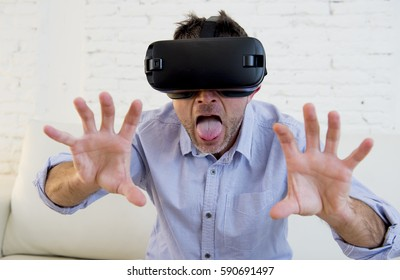 young pervert man at home living room sofa couch excited using 3d goggles watching 360 virtual reality vision enjoying as if touching virtual woman brest in cyber sex experience vr simulation reality