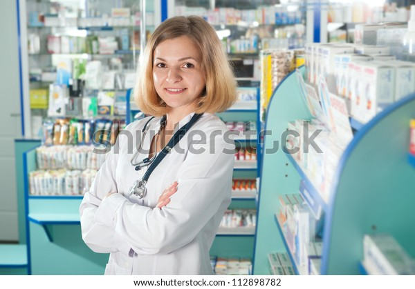 Young pharmacist with phonendoscope in drugstore