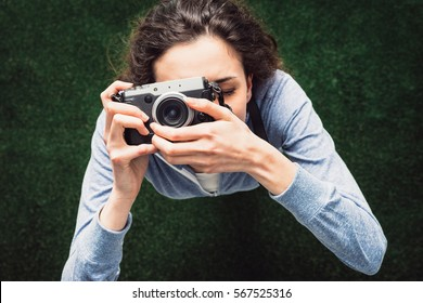 Young photographer girl shooting outdoors, hobbies and leisure concept, top view