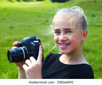 Young photographer and reflex camera. Children photographing