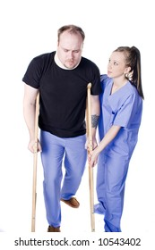 Young physical therapist helping injured man with crutches