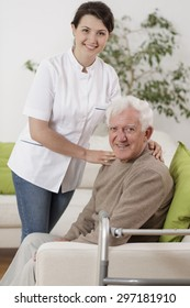 Young physiotherapist supporting senior patient during rehabilitation