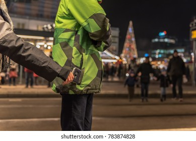 Young pickpocket are stealing mobile phone from jacket pockets in public. Concept: security