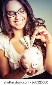 Young piggy bank money woman