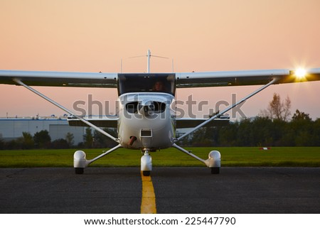 Young pilot is preparing for take off with private plane.