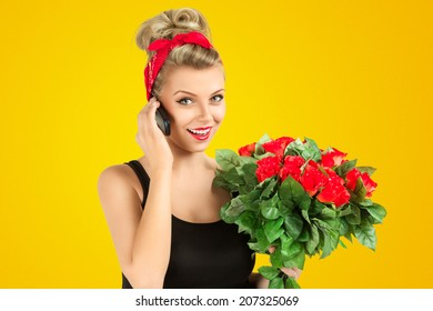 Young pin-up style woman talking by mobile phone