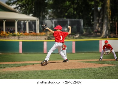 Young pitcher on the mound in a youth baseball game