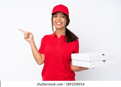 Young Pizza delivery girl over isolated white background pointing finger to the side