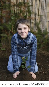 Young Planting a Tree to Protect the Planet Earth