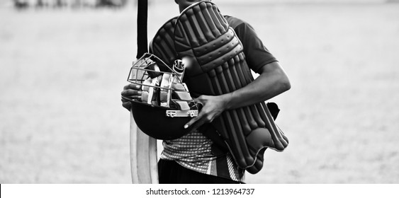 Young player holding the cricket gears in hand unique photo