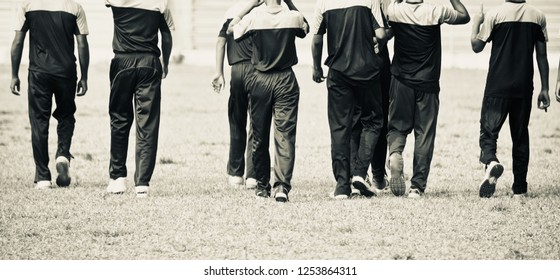 Young players walking in a field unique photo