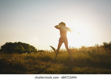 Young playful hippie woman enjoying on a summer day in nature