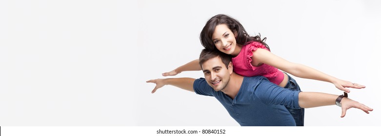 young playful involved couple posing as flying