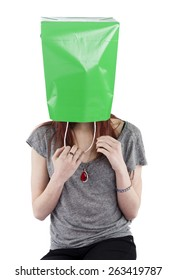 Young Playful Teenage Woman Hiding with Green Shopping Bag over Head Obscuring Face and Identity