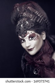 Young plump woman in creative image  in russian style  with artistic red and white visage