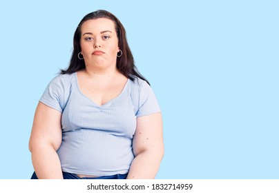 Young plus size woman wearing casual clothes depressed and worry for distress, crying angry and afraid. sad expression.