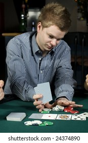 Young poker player going all in during game