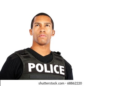 young police officer watches for trouble