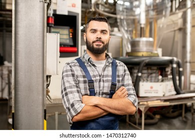 Young polymer processing tube engineer with his arms crossed by chest
