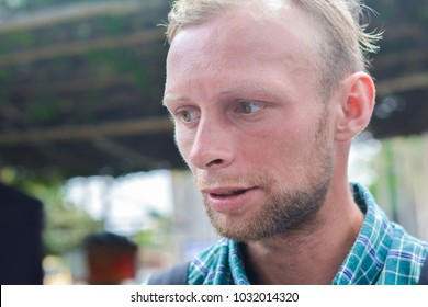 Young poor caucasian man with beard.