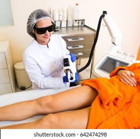 Young positive girl removing hair from legs with laser