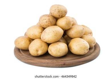 Young potatoes on a cutting board on white background close-up. Selective focus.