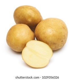 Young potatoes whole and slice isolated on white background. Harvest new. Flat lay, top view