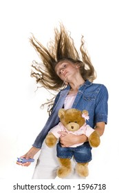 young, pre teen girl dancing with teddy bear and mp3 player