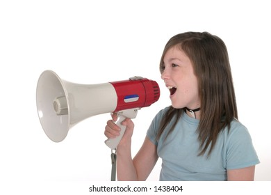 Young pre teen or tween girl shouting, speaking, or singing through a megaphone. Shot on white