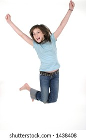 Young pre teen or tween girl jumping up in the air with arms outstretched.  Shot on white.