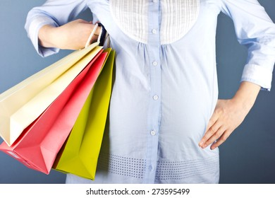 young pregnant blond woman on shopping.woman couple shopping portrait. Shopping bags.