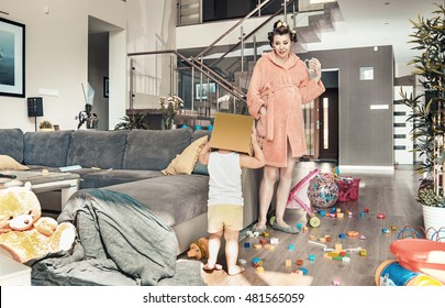 Young pregnant mother and her little daughter, at home