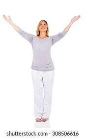 young pregnant woman with arms outstretched looking up