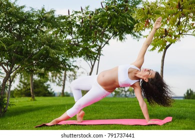 Young pregnant woman doing yoga