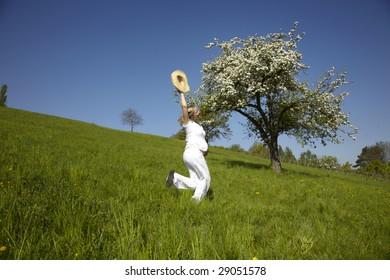 young pregnant woman enjoys nature