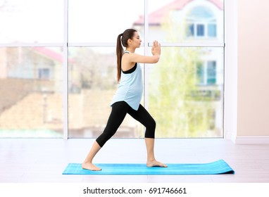 Young pregnant woman training in gym. Health concept