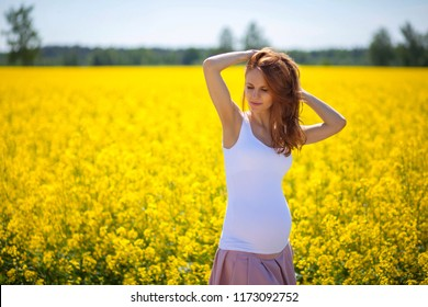 young pregnant woman walking outdoors
