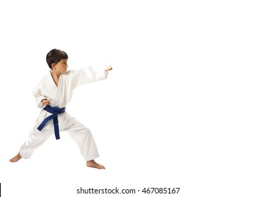 Young , preschool boy in kimono, isolated on white background