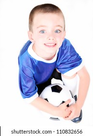 Young preschool boy with a soccer ball on white background