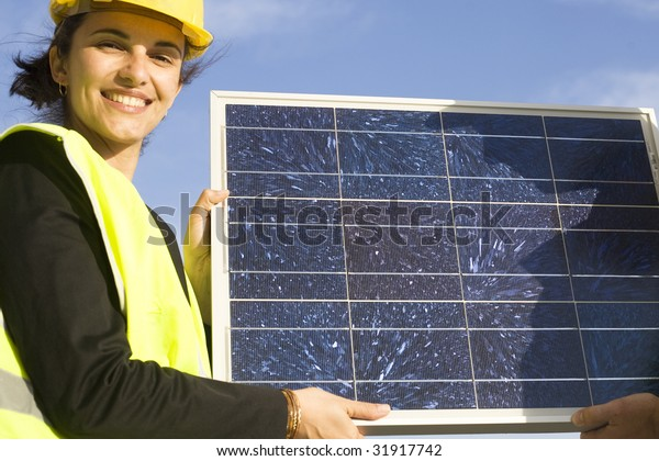 Young presenting a solar panel
