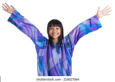 Young preteen Asian girl in Malay traditional dress 'baju kurung' over white background