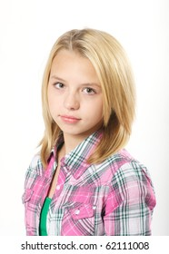 Young, pre-teen girl with a serious look in studio.