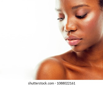 young pretty african american woman naked taking care of her skin