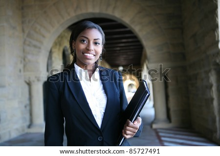 A young and pretty african american woman at college