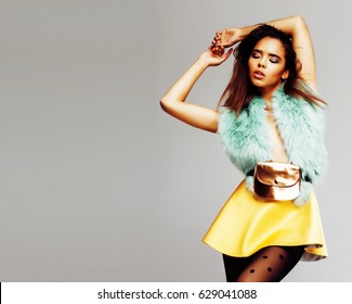 young pretty african-american woman posing in fashion clothers emotional, lifestyle people concept