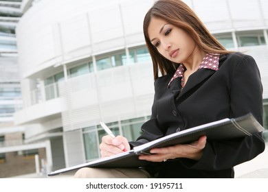 A young pretty asian business woman at her company