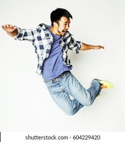young pretty asian man jumping cheerful against white background