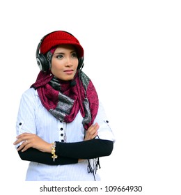 young pretty Asian muslim business woman in head scarf with earphone against white background